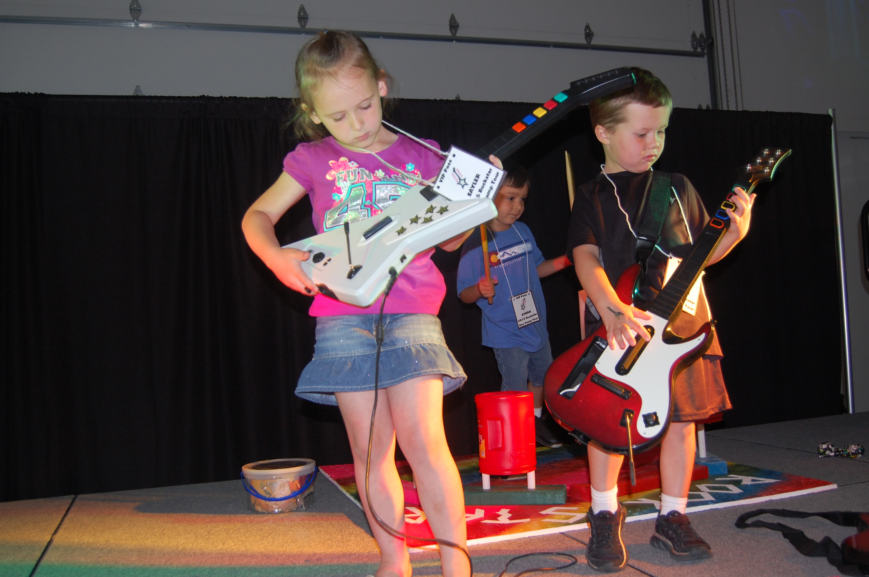 kids playing on stage