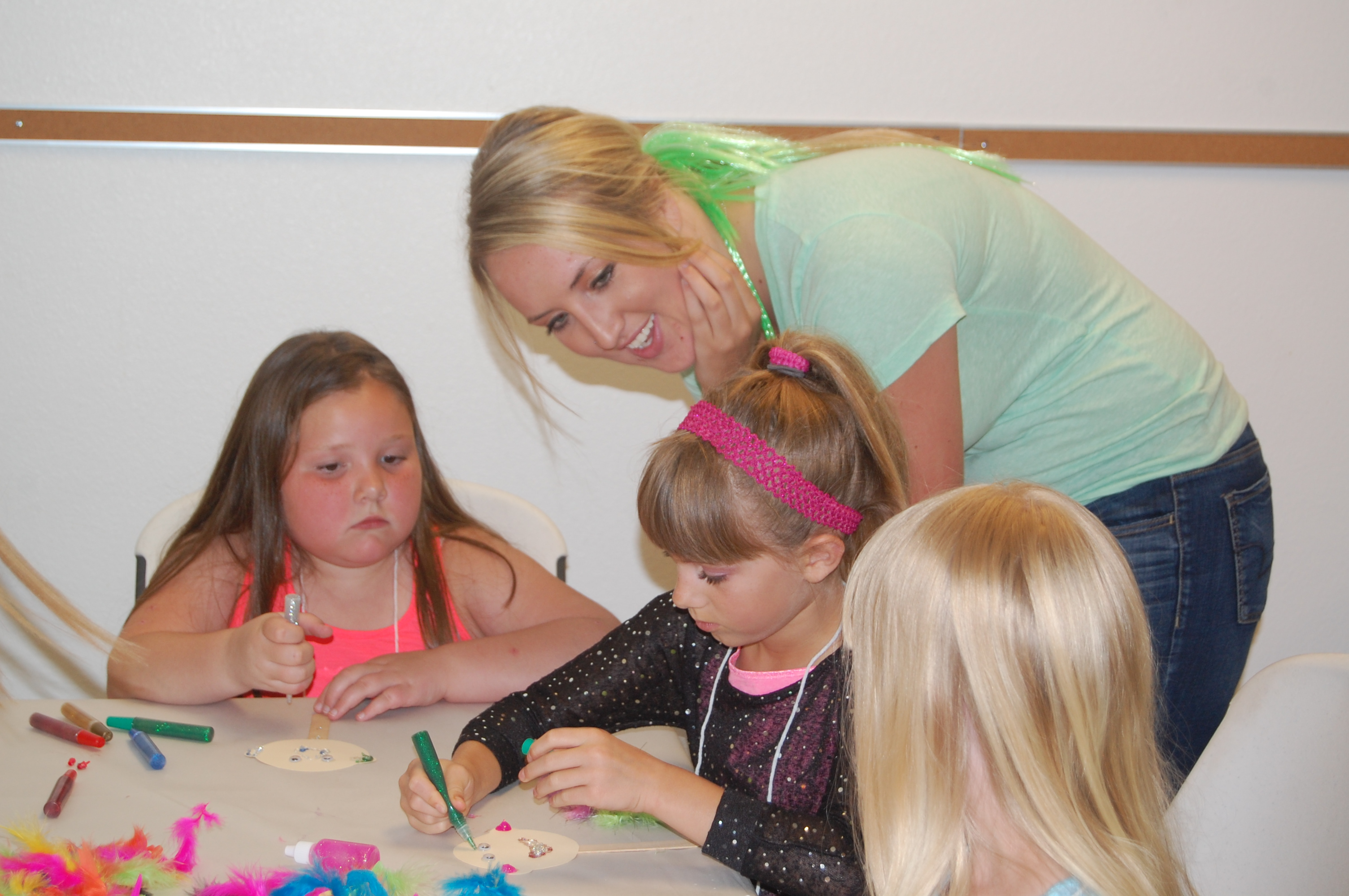 Jade helping kids with craft