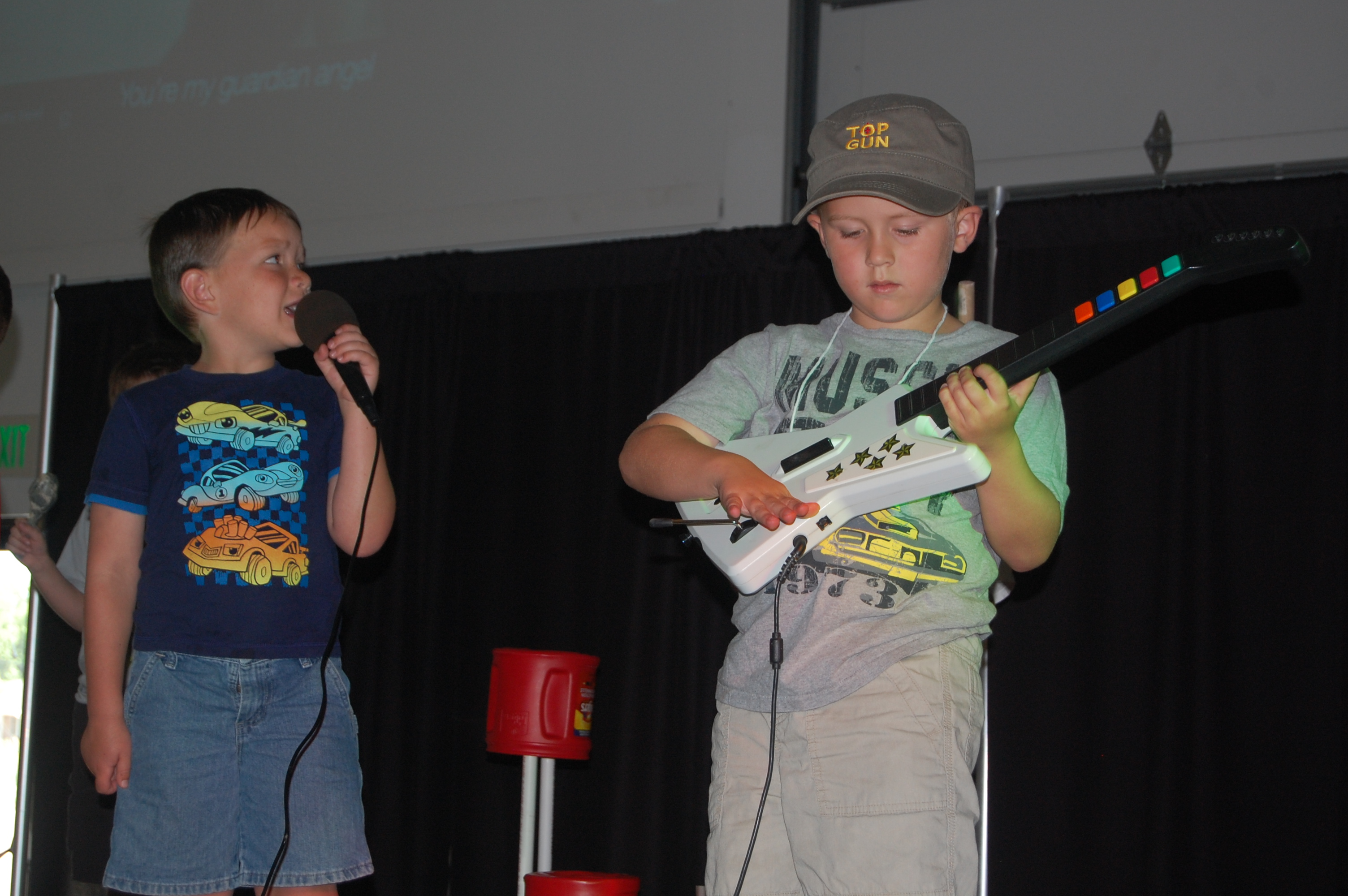 Cash and Tobyn performing on stage