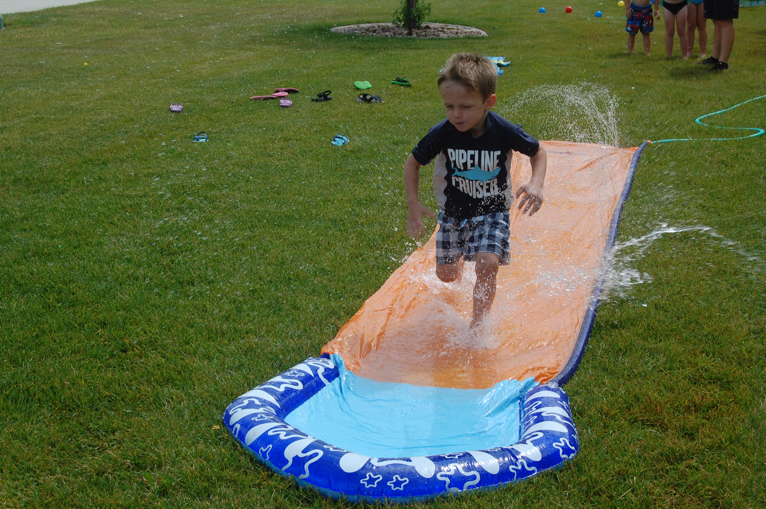 Samuel on the slip n slide